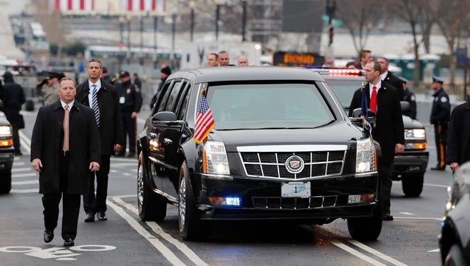 President Donald J. Trump inside the Presidential Limosuine called 'The Tank' along Pennsylvania Ave. during the Inaugural Parade after Donald J. Trump was sworn in as the 45th President of the United States in Washington, DC, USA, 20 January 2017.
