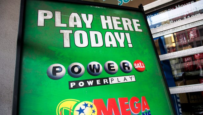 A sign for the multi-state Powerball lottery is pictured outside store in Washington D.C.