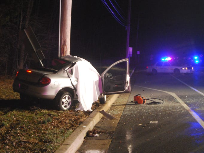State police say two women in their 20s died when this Dodge Neon struck a utility pole on Paper Mill Road (Del. 72) in Milford Crossroads, north of Newark.