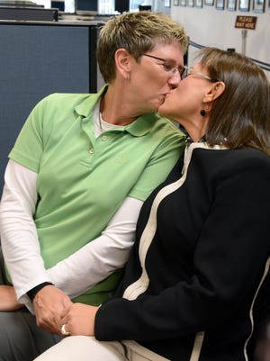 Karen Goody, left, and Karen Vibe kiss as they apply for their marriage license, the first to be issued in Washoe County to the same sex couple on Thursday Oct. 9, 2014.