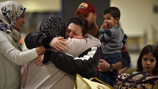 An Iraqi family from Woodbridge, Va, welcomes their grandmother at Dulles International Airport Feb. 5, 2017.
