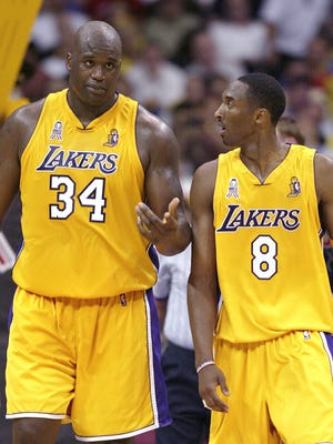 Shaquille O'Neal and Kobe Bryant talk during Game 1 of the 2002 NBA Finals at the Staples Center.