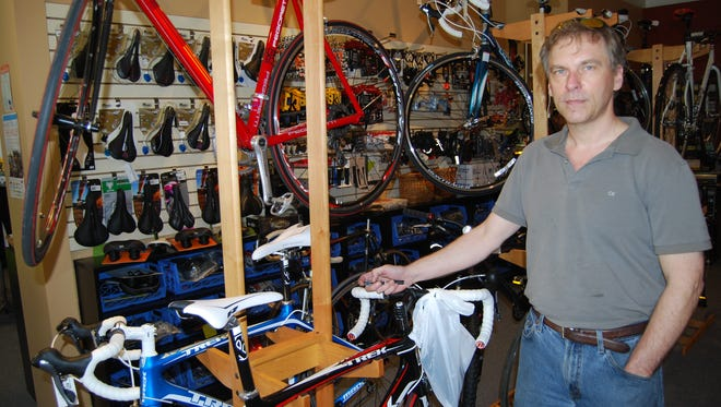 Oakley Cycles owner David Ariosa poses for a photo in 2010. Oakley Cycles is moving to Columbia Township in January and re-branding as Fifty West Cycling Company.