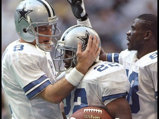 Troy Aikman (left), Emmitt Smith (center) and Michael Irvin make up the Dallas Cowboys' original triplets. Which one did USA Today rank highest on their top 100 list of greatest Dallas Cowboys of all time?
