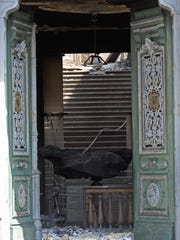 A meteorite on exhibit at the National Museum is seen through a door after an overnight fire in Rio de Janeiro, Brazil.