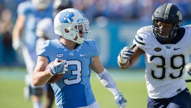 North Carolina Tar Heels wide receiver Ryan Switzer (3) runs after a catch while Pittsburgh Panthers linebacker Saleem Brightwell (39) pursues in the second quarter at Kenan Memorial Stadium.