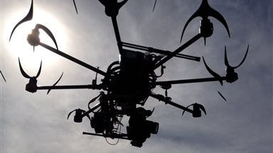 This image provided by Aerial MOB, LLC, shows their eight rotor Sky Jib Helicopter in San Diego, Calif., in August 2013. The Federal Aviation Administration is expected to announce Thursday, Sept. 26,  that it is granting permits to seven movie and television production companies to fly drones, including those from Aerial MOB, LLC, an important step toward greater use of the technology by commercial operators, said attorneys and a company official familiar with the decision. The seven companies have been working with the Motion Picture Association of America for two years to win approval from the FAA.