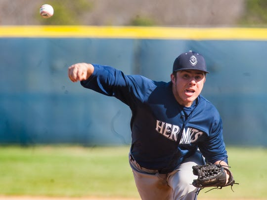 Jack Billings delivers a pitch during St. Augustine's showdown with Millville on Monday. A reliever last season, he is now a starter for the Hermits.