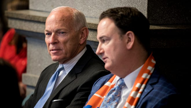 CEO of KMK Consulting Jim McGraw and FC Cincinnati general manager Jeff Berding wait for City Council members to vote on an infrastructure financing plan for FC Cincinnati at City Hall in downtown Cincinnati Wednesday, November 29, 2017.