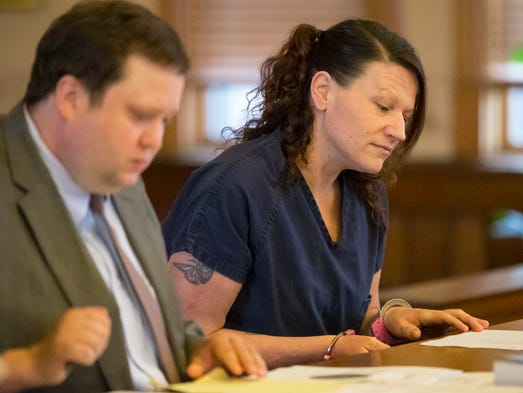 Kelly Cochran looks over some paperwork with her lawyer
