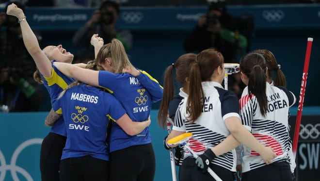 Sweden celebrates winning the gold medal against South Korea during the Womens Curling Team Final during the Pyeongchang 2018 Olympic Winter Games at Gangneung Curling Centre.