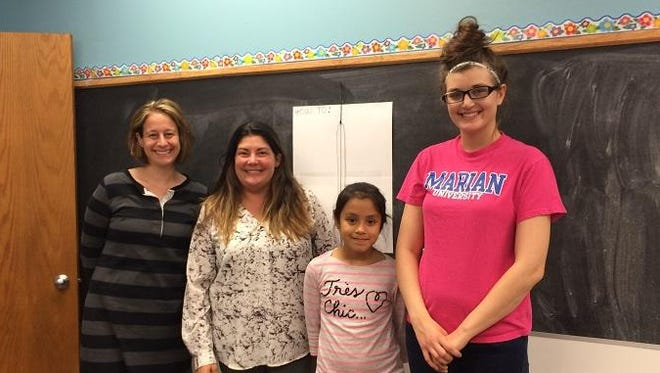 """Volunteers who assisted in modifying the Box of Rocks fundraiser this year included, from left: Katie Reinke, Agnesian In-Patient Pharmacy; Denae Leffin, Agnesian In-Patient Pharmacy; Martha, a Big Brothers Big Sisters """"Little;"""" Kayli Posvic, Martha's BBBS """"Big."""""""