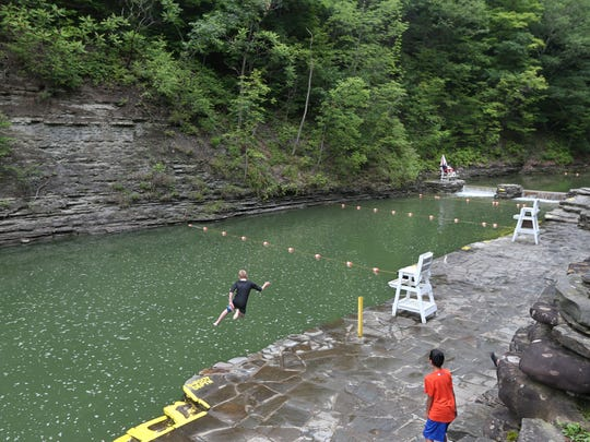 One brave youth makes a running leap into the deepest section of the naturally formed swimming pool at Stony Brook State Park.  With air temps reaching only 68, and the water at 60 degrees, most park visitors passed on taking a swim on this day.
