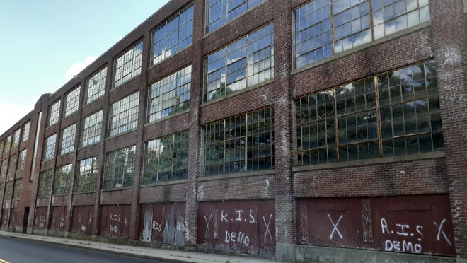 New graffiti on one of the former Draper factory buildings.