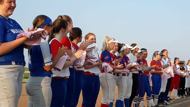 The Area All-Stars line up to be recognized before the start of Game 2 of a showcase doubleheader Monday at the Land of Lincoln Junior Olympic Softball/University of Illinois Springfield softball field.