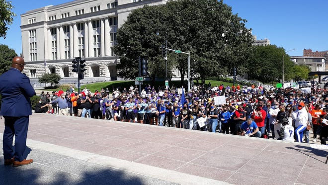 Mylas Copeland, left, addresses the crowd in front of the Illinois State Capitol building during the #LetUsPlay rally on Saturday, Sept. 19, in Springfield, Illinois.