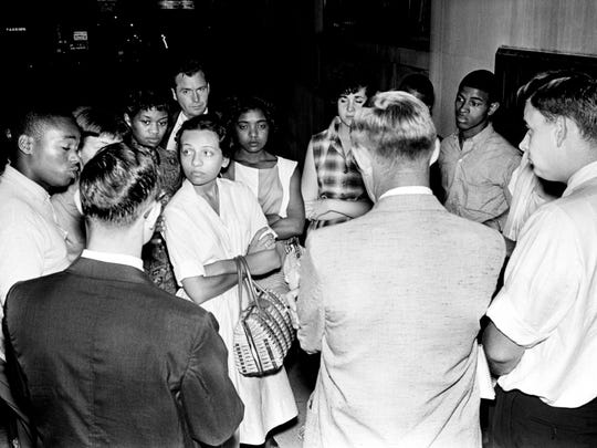 A group of 12 blacks and whites demonstrators marched on WLAC-TV's studios Aug. 8, 1961, to see Mayor Ben West, who was appearing on a new program being broadcast. Diane Nash, center of circle, leader of the group, said they wanted to protest lack of police protection in connection with their picketing. Mayor West however taped the program earlier and was already gone.