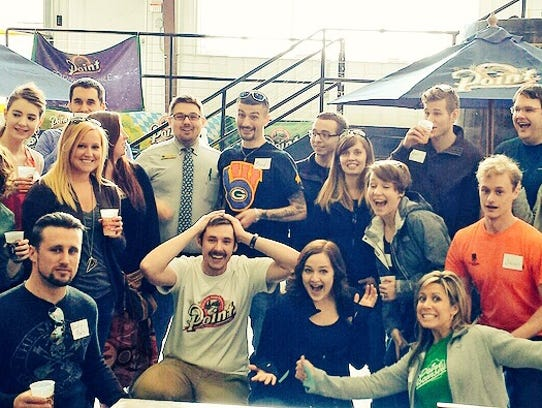 Wausau's young professionals group tours a brewery