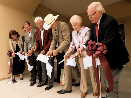 NMSU president Garrey Carruthers, center, Provost Dan Howard, third from right, members of the Jacobs family, and other community leaders participate in a special ribbon-cutting ceremony at the site of the new Hardman and Jacobs Undergraduate Learning Center. (Photo by Darren Phillips)