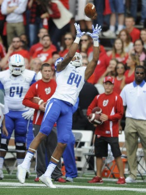 Blue Raider wide receiver Terry Pettis (84) make a catch falling out of bounds.