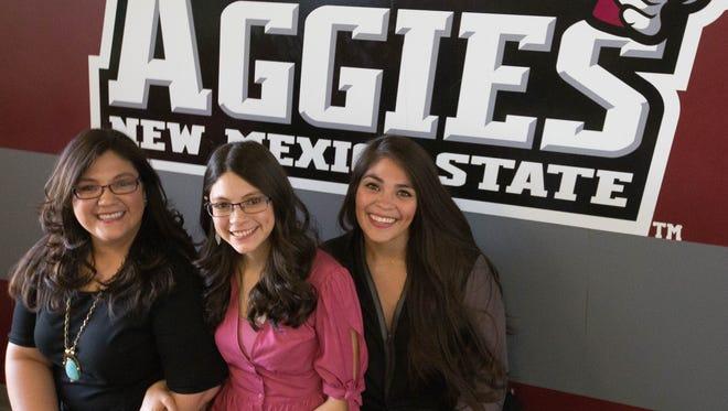Marissa Fowler, left, Mirabella Macias, center, Adriana Macias, right, are three sisters all graduating Saturday from New Mexico State University. Monday May 7, 2018.