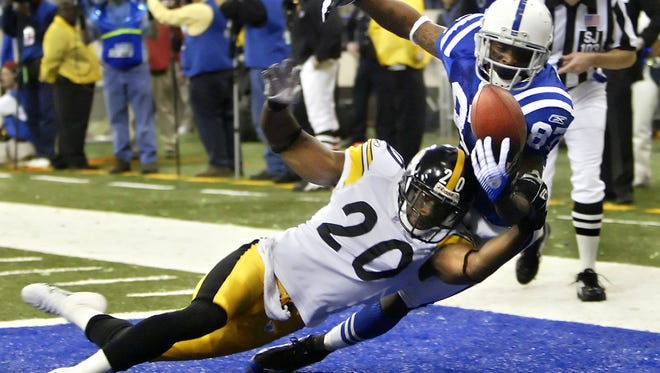 Indianapolis Colts wide receiver Reggie Wayne has the potential game-winning touchdown pass stripped out of his hands by Pittsburgh cornerback Bryant McFadden with 31 seconds left on the clock in the fourth quarter of the second-round AFC playoffs, Jan. 15, 2006.