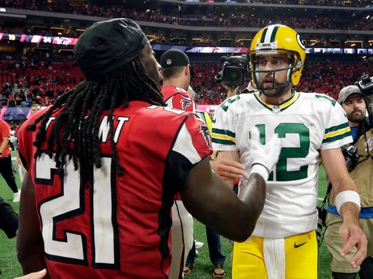 Packers quarterback Aaron Rodgers (12) greets Falcons cornerback Desmond Trufant after the game.