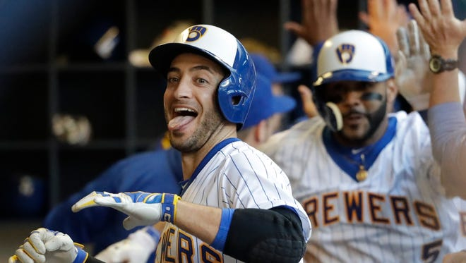 The celebration ritual in the dugout after home runs is one way the Brewers players have built camaraderie.