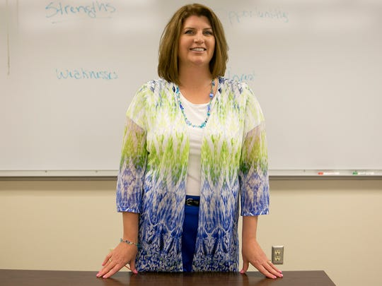 Debby Wallner poses in front of her class at Mid-State Technical College in Wisconsin Rapids.