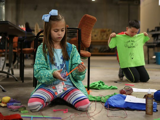 Aleya Levens uses random objects to design her T-shirt as part of a Trashion Fashion project during spring break camp at the San Angelo Museum of Fine Arts, Wednesday, March 14, 2018.