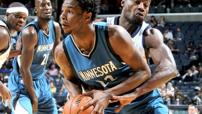 October 18, 2015 -  Memphis Grizzlies Tony Allen smothers Minnesota Timberwolves Andrew Wiggins on defense forcing a turnover during the preseason game at FedExForum.