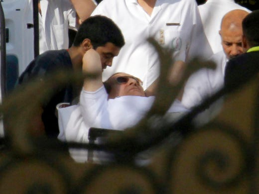 Medical personnel move former Egyptian president Hosni Mubarak into an ambulance at the Maadi Military Hospital on Aug. 22 in Cairo. The former leader was ordered released from Tora prison after two years in detention.