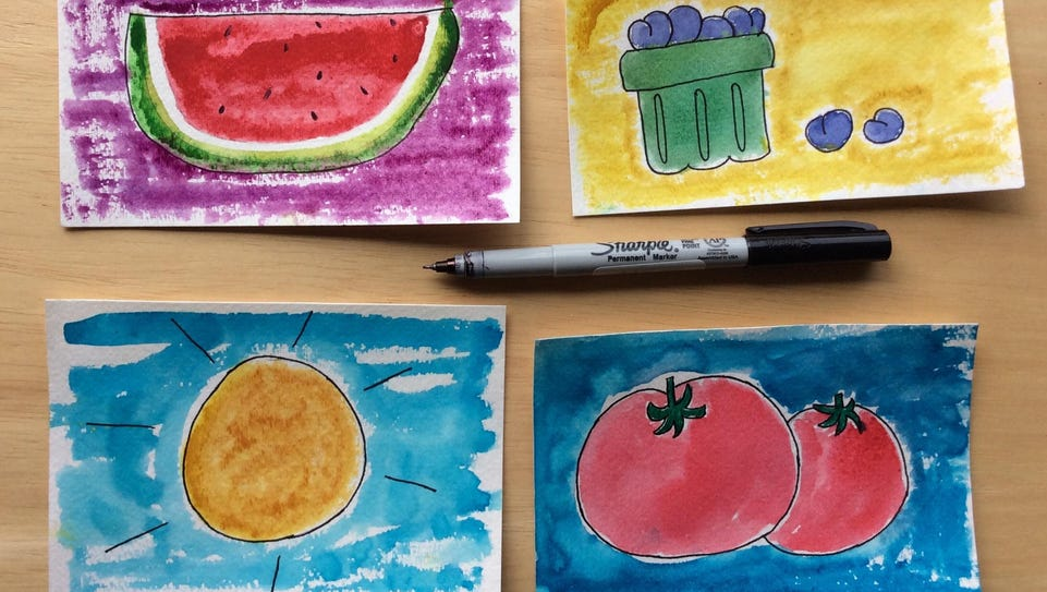 Outline your watercolor postcards with black ink to