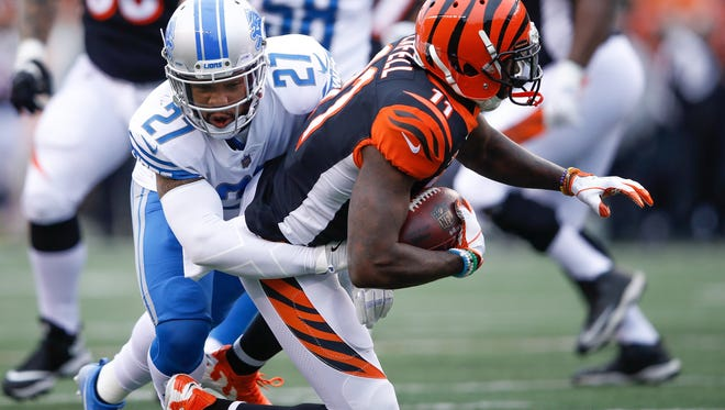 Glover Quin (27) of the Detroit Lions tackles Brandon LaFell (11) of the Cincinnati Bengals after a reception during the first half at Paul Brown Stadium on December 24, 2017 in Cincinnati, Ohio.