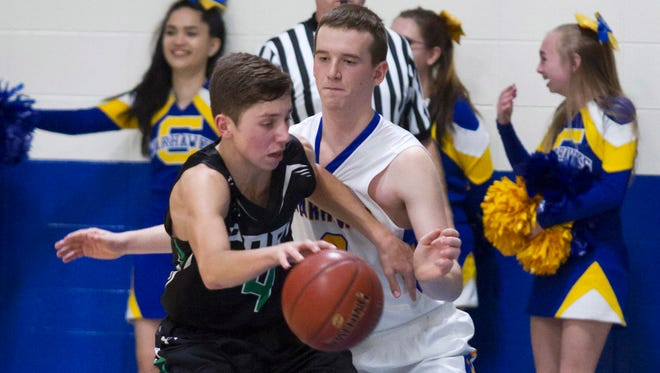 Adam Baierl (left) was the leader for the Port Washington boys basketball team last season, when the Pirates finished 5-18 overall.