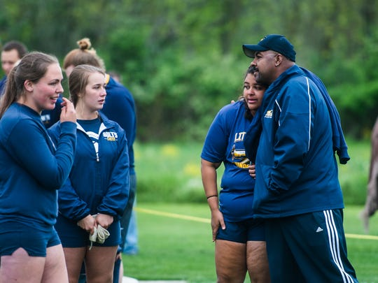 Littlestown's Bre Smith gets a hug from her dad and coach Jay Smith on Thursday May 5, 2016 during track and field meet against Biglerville.