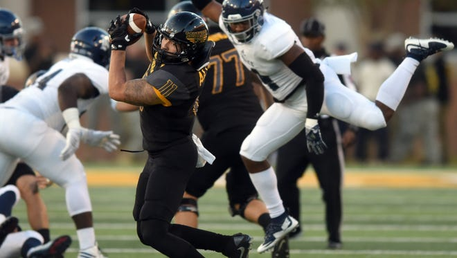 Southern Mississippi's Julian Allen catches the ball against Rice during Saturday's game.