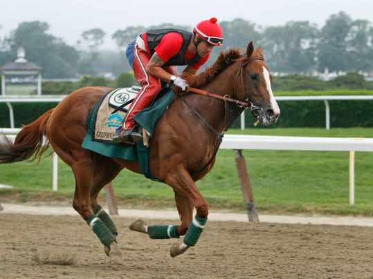 Exercise rider Willie Delgado gallops California Chrome on a second lap during a workout at Belmont Park, Wednesday, June 4, 2014, in Elmont, N.Y. The Kentucky Derby and Preakness Stakes winner will attempt to become the first Triple Crown winner since Affirmed in 1978 when he races in the 146th running of the Belmont Stakes horse race on Saturday. (AP Photo/Peter Morgan)