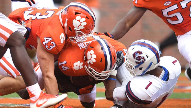 Clemson Denzel Johnson (14) recovers a fumble by SC State wide receiver Ahmaad Harris (1) in the end zone for a TD during the 1st quarter on Saturday, September 17, 2016 at Clemson's Memorial Stadium.