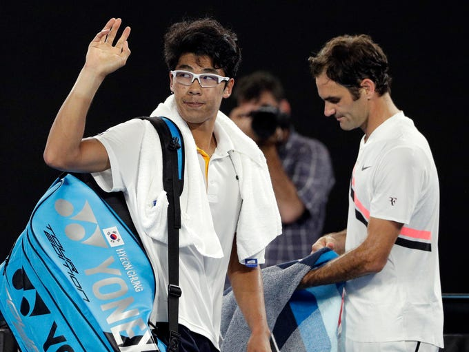 Hyeon Chung waves as he leaves Rod Laver Arena after