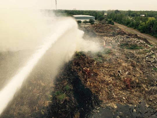 Firefighters are on the scene of a mulch fire in south Lee County