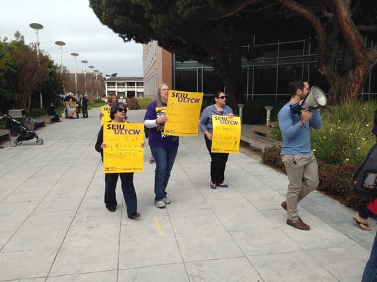 Caregivers picket Tuesday outside the Monterey County Government Building