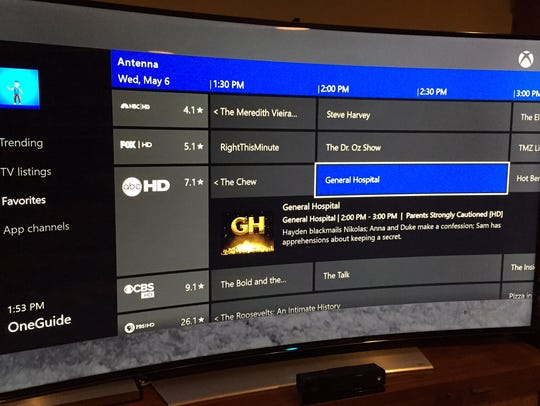 A screen shot of the Xbox One OneGuide menu with local