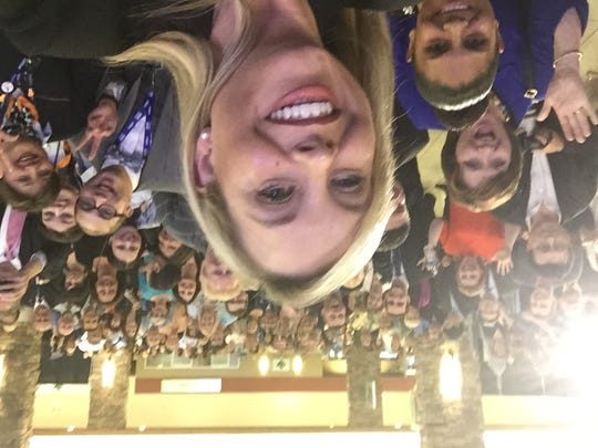 Reno Mayor Hillary Schieve takes a selfie with the assembled crowd celebrating the landing of the first JetBlue nonstop flight from New York at the Reno-Tahoe International Airport on Thursday night.