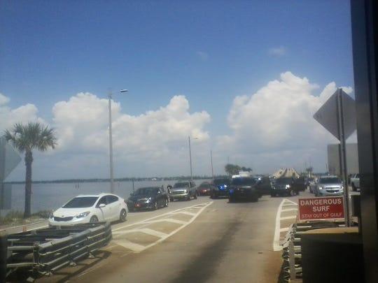 U.S. Marshals stop an SUV on Bob Sikes bridge.