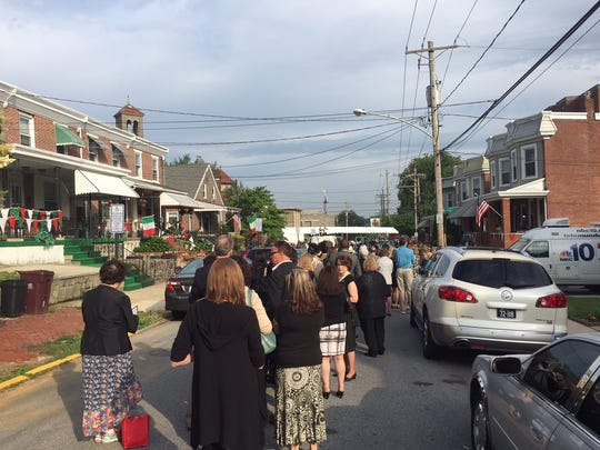 Mourners begin to line up before 8 a.m. at St. Anthony