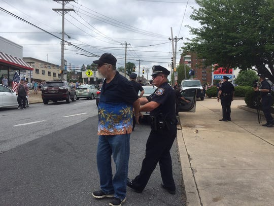 One man is taken into custody after throwing coffee