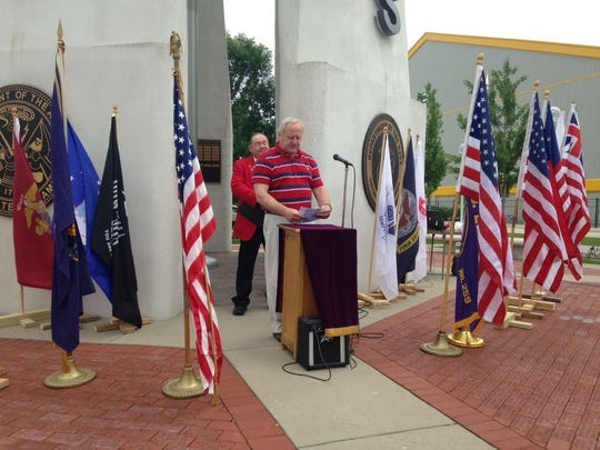 State Sen. Dave Hansen reads a proclamation at the Green Bay Elks Lodge 259's annual Flag Day Service on Sunday.