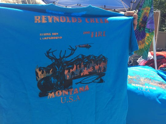 William Clayton, who designs T-shirts, was selling Reynolds Creek fire shirts in St. Mary Thursday.