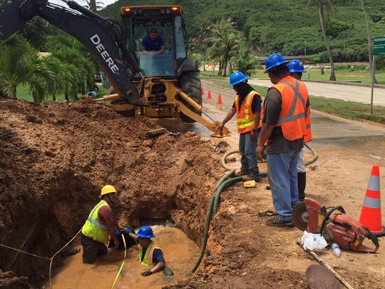 A Guam Waterworks Authority crew works to repair a